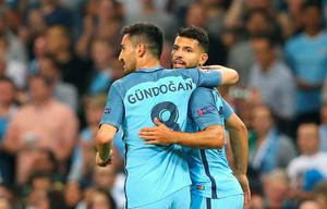 MANCHESTER, ENGLAND - SEPTEMBER 14:  Ilkay Gundogan congratulates Sergio Aguero of Manchester City after scoring his teams opener during the UEFA Champions League match between Manchester City FC and VfL Borussia Moenchengladbach at Etihad Stadium on September 14, 2016 in Manchester, England.  (Photo by Alex Livesey/Getty Images)
