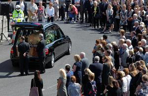 The coffin of Eimear Walsh arrives at Our Lady of Perpetual Succour in Foxrock, Dublin, for her funeral after she died when a balcony collapsed in the college town of Berkeley, California. PRESS ASSOCIATION Photo. Picture date: Tuesday June 23, 2015. See PA story FUNERAL Balcony. Photo credit should read: Brian Lawless/PA Wire