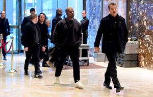 Singer Kanye West(C) arrives at Trump Tower December 13, 2016 as US President-elect Donald Trump continues to hold meetings In New York. / AFP PHOTO / TIMOTHY A. CLARYTIMOTHY A. CLARY/AFP/Getty Images