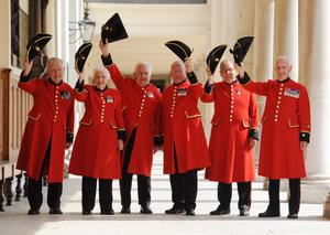Chelsea Pensioners celebrate the birth of the Duke and Duchess of Cambridge's son at the Royal Chelsea Hospital in London by toasting and sending the royal couple a small Royal Hospital teddy bear dressed in traditional scarlet uniform. Stefan Rousseau/PA Wire