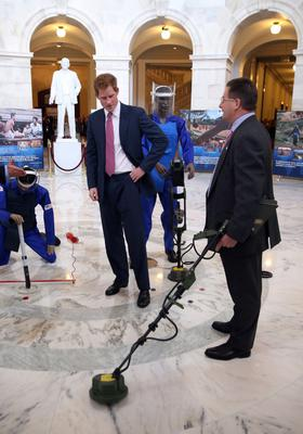 WASHINGTON, DC - MAY 09:  HRH Prince Harry (C) tours an anti-landmine photography exhibition by The HALO Trust charity during the first day of his visit to the United States at the Russell Senate Office Building on May 9, 2013 in Washington, DC. HRH will be undertaking engagements on behalf of charities with which the Prince is closely associated on behalf also of HM Government, with a central theme of supporting injured service personnel from the UK and US forces.  (Photo by Chris Jackson/Getty Images)