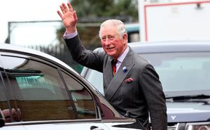 The Prince of Wales waves to well-wishers outside the Eglinton Community Centre in Londonderry during a visit to communities hit by the summer's flash floods.  Laura Hutton/PA Wire