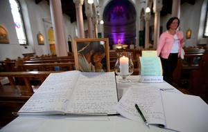 Books of condolence for the victims of the Berkeley balcony collapse are opened at Our Lady of Perpetual Succour church in Foxrock, Dublin. PRESS ASSOCIATION Photo. Picture date: Thursday June 18, 2015. The victims - five from Ireland and one from California - plunged to their deaths while celebrating a 21st birthday party in the US city. See PA story IRISH Balcony. Photo credit should read: Niall Carson/PA Wire