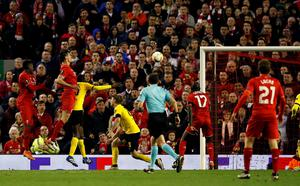 Liverpool's Dejan Lovren (second from left) scores his side's fourth goal of the game during the UEFA Europa League Quarter Final, Second Leg match at Anfield, Liverpool. PA