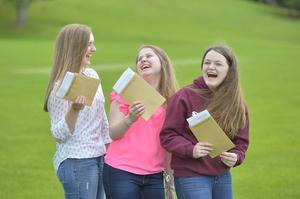 A Level results at Banbridge Academy in Co Down. Pictured are Chartlotte Hawthorne 3 A* in Chemistry, Biology and Maths Charlotte McCrum 3 A* Biology, Chemistry and Maths and Sarah Thompson A. A. C.  Biology, Geography and Religious Education. Picture Mark Marlow