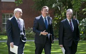 Prime Minister David Cameron (centre) walks with Northern Ireland's Deputy First Minister Martin McGuinness (left) and Northern Ireland's First Minister Peter Robinson (right) for a press conference in the garden of 10 Downing Street in central London. PRESS ASSOCIATION Photo. Picture date: Friday June 14, 2013. An economic pact to help Northern Ireland's struggling economy will be agreed at Westminster. Initiatives to stimulate private sector investment and job creation, boost lending to businesses and deliver capital funding for frontline projects such as hospitals, schools and roads are expected to be included in the package which will be announced at Downing Street. Mr Cameron said the ambitious package would help strengthen the foundations for peace and send a positive message ahead of next week's G8 summit at Lough Erne. See PA story ULSTER Economy. Photo credit should read: Will Oliver/PA Wire