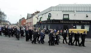 Alan Lewis - PhotopressBelfast.co.uk    22/3/2016 Mandatory Credit - Picture by Justin Kernoghan Family members weep as close family and friends help to carry Adrian's coffin at his funeral in the Shankill area of Belfast - The funeral for prison officer Adrian Ismay who died following a dissident republican bomb attack took place in Belfast today. Mr Ismay, 52, was seriously injured after a booby-trap device exploded under his van in east Belfast on 4 March. He was said to be recovering well, but died in hospital last Tuesday. A group calling itself the new IRA said it carried out the attack. A man has appeared in court charged with murder.