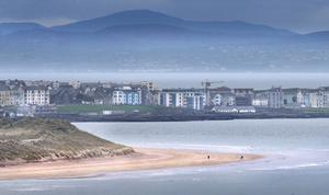 A self isolating walk along Whiterocks beach near Portrush, Co-Antrim during Easter weekend, across the bay from Co-Donegal in Republic of Ireland. Picture Margaret McLaughlin