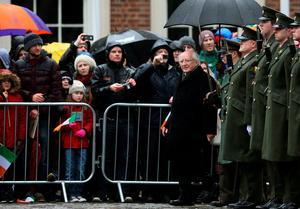 President Michael D. Higgins (sixth left) inspects a guard of honour during the first major event to mark the centenary of the 1916 Rising, at Dublin Castle in Ireland. PRESS ASSOCIATION Photo. Picture date: Friday January 1, 2016. Three flags which were flown on O'Connell Street during the rebellion were raised over Dublin Castle in the ceremony attended by President Michael D Higgins, Taoiseach Enda Kenny and Tanaiste Joan Burton. See PA story POLITICS Rising Ireland. Photo credit should read: Brian Lawless/PA Wire