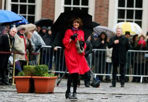Tanaiste Joan Burton (centre) arrives for the first major event to mark the centenary of the 1916 Rising, at Dublin Castle in Ireland. PRESS ASSOCIATION Photo. Picture date: Friday January 1, 2016. Three flags which were flown on O'Connell Street during the rebellion were raised over Dublin Castle in the ceremony attended by President Michael D Higgins, Taoiseach Enda Kenny and Tanaiste Joan Burton. See PA story POLITICS Rising Ireland. Photo credit should read: Brian Lawless/PA Wire