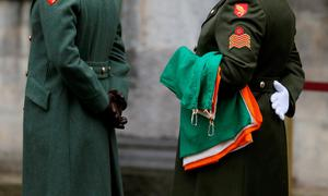 A member of the Irish defence forces holds the National Flag which was flown from the GPO on O'Connell Street during the rebellion, as the first major event to mark the centenary of the 1916 Rising takes place at Dublin Castle in Ireland. PRESS ASSOCIATION Photo. Picture date: Friday January 1, 2016. Three flags which were flown on O'Connell Street during the rebellion were raised over Dublin Castle in the ceremony attended by President Michael D Higgins, Taoiseach Enda Kenny and Tanaiste Joan Burton. See PA story POLITICS Rising Ireland. Photo credit should read: Brian Lawless/PA Wire