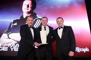 Manager of the Year winner: Michael O'Neill. Michael is presented with his award from  Bolton Wanderers manager Neil Lennon and Richard McClean, Managing Director, Belfast Telegraph. Picture by Kelvin Boyes/ Press Eye