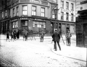 RIOTS: BELFAST 1922. On Friday the police and military carried out a search in the Carrick Hill neighbourhood of Belfast. Picture shows the military cordon and knife rest barricade at the North Street end of Upper Library Street, formerly known as Carrick Hill. 03/06/22. 1922-164.