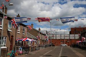 Israeli flags hang alongside Union flags and a UVF flag in Cluan Place, Belfast, as Loyalist and Republican groups take rival positions of support for Israel and Palestine during the current flare up in the conflict
