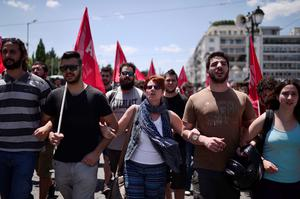 Leftist protesters march in central Athens after occupying the European parliament  offices in Athens, on July  2, 2015.  Greece's Prime Minister Alexis Tsipras said Thursday his country would remain united after the upcoming referendum, rejecting concerns the vote on bailout measures is splitting the country in two. AFP PHOTO/ Louisa GouliamakiLOUISA GOULIAMAKI/AFP/Getty Images