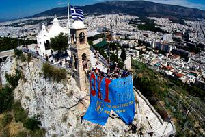 Anti-EU protesters hang a banner which translates as ''No to austerity, no to fear'' from Lycabettus hill in Athens on July 2, 2015. Greece's radical left government suggested it would resign if it fails to get its way in a make-or-break referendum July 5 that could decide the country's financial future.  AFP PHOTO / EUROKINISSI / Antonis NikolopoulosAntonis Nikolopoulos/AFP/Getty Images