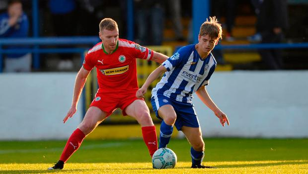 Steady form : Chris Curran (left), pictured with Coleraine's Ciaron Harkin, believes Cliftonville have been improving as manager Barry Gray has settled into his role this year