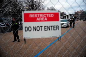 Members of US Secret Service guard a fenced out area near the White House in Washington, DC, on January 19, 2017, where final preparations are underway a day ahead the inauguration of US President-elect Donald Trump as the 45th President of the US.         / AFP PHOTO / Jewel SAMADJEWEL SAMAD/AFP/Getty Images