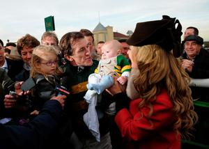 TOWCESTER, ENGLAND - NOVEMBER 07:  Tony McCoy riding Mountain Tunes celebrates with his family after winning the Weatherbys Novices' Hurdle Race for his 4000th winner on November 7, 2013 in Towcester, England.  (Photo by Shaun Botterill/Getty Images)