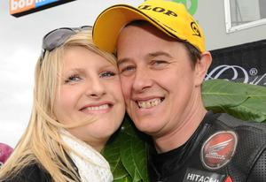 Pacemaker Press   15/5/2010 John McGuinness celebrates his win in the superbike race with partney Becky during todays North West 200 International races in Northern Ireland. Photo Stephen Davison/Pacemaker Press
