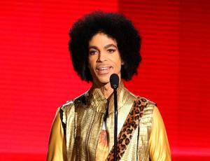 FILE - In this Nov. 22, 2015 file photo, Prince presents the award for favorite album - soul/R&B at the American Music Awards in Los Angeles. Authorities are investigating a death at Paisley Park, where pop superstar Prince has his recording studios. Jason Kamerud, Carver County chief sheriff's deputy, tells the Minneapolis Star Tribune that the investigation began on Thursday morning, April 21, 2016. (Photo by Matt Sayles/Invision/AP, File)