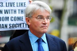 Former cabinet minister Andrew Mitchell MP arrives at the High Court in London, where a judge was due to rule on libel actions involving the former Government chief whip and Pc Toby Rowland.