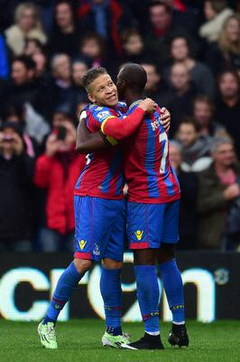 Crystal Palace's Dwight Gayle (left) celebrates scoring their first goal of the game with team-mate Yannick Bolasie who claims the assist during the Barclays Premier League match at Selhurst Park, London. Adam Davy/PA Wire.