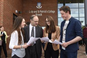 Education Minister, Peter Weir, pictured at a visit to Our Lady's and St Patrick's College with pupils, Eimear Rogers (left) and Clare Dempsey and Joseph McKervey. Picture: Michael Cooper