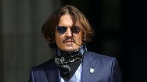 Johnny Depp denies the allegations of violence made against him by Amber Heard (Aaron Chown/PA)