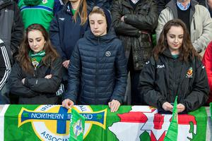 Northern Ireland fans observe a minutes silent in respect to Sean McGrotty, 49, his sons Mark, 12, and Evan, 8, his mother-in-law Ruth Daniels, 59, and Ms Daniels' daughter Jodie Lee Daniels, who was 14 who died in Buncrana, Co. Donegal before an International Friendly at Windsor Park, Belfast. PA