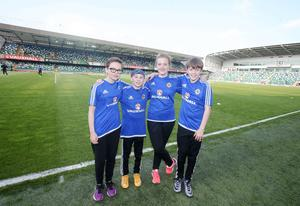 Press Eye - Belfast - Northern Ireland - 27th May 2016  Vauxhall International Challenge Match Northern Ireland Vs Belarus at the National Football Stadium at Windsor Park, Belfast.  Left to right.  Flag bearers Jody Burns, Alex Corr, Sara Lockhead and Benjamin Jackson  Picture by Jonathan Porter/PressEye