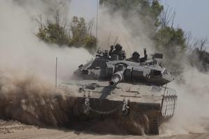 An Israeli tank moves along the border on July 20, 2014 on the Israel/Gaza Strip border. (Photo by Lior Mizrahi/Getty Images)