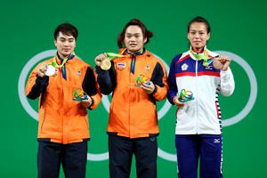 RIO DE JANEIRO, BRAZIL - AUGUST 08:  (L-R) Silver medalist Pimsiri Sirikaew of Thailand, gold medalist Sukanya Srisurat of Thailand and bronze medalist Hsing-Chun Kuo of Chinese Taipei pose on the podium during the medal ceremony for the Women's 58kg Group A weightlifting contest  the on Day 3 of the Rio 2016 Olympic Games at the Riocentro - Pavilion 2 on August 8, 2016 in Rio de Janeiro, Bra  (Photo by Lars Baron/Getty Images)