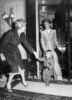 """(FILES) This file photo taken on February 17, 1974 shows British rock star David Bowie, with his wife Angela (Angie) and his son Zowie, after receiving an award for his latest record """"Ziggy stardust"""" in Amsterdam. British rock music legend David Bowie has died after a long battle with cancer, his official Twitter and Facebook accounts said on January 11, 2016. Bowie died on Januray 10 surrounded by family according to his social media accounts. The iconic musician had turned 69 only on January 8, which coincided with the release of """"Blackstar"""", his 25th studio album. / AFP / STRINGERSTRINGER/AFP/Getty Images"""