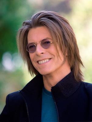 """(FILES) This file photo taken on October 14, 1999 shows British rock star posing October 14, 1999 in Paris during a press conference. British rock music legend David Bowie has died after a long battle with cancer, his official Twitter and Facebook accounts said on January 11, 2016. Bowie died on Januray 10 surrounded by family according to his social media accounts. The iconic musician had turned 69 only on January 8, which coincided with the release of """"Blackstar"""", his 25th studio album. / AFP / ERIC FEFERBERGERIC FEFERBERG/AFP/Getty Images"""