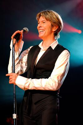 "(FILES) This file photo taken on July 1, 2002 shows British singer David Bowie performing in Paris during his only Paris gig.  British rock music legend David Bowie has died after a long battle with cancer, his official Twitter and Facebook accounts said on January 11, 2016. Bowie died on Januray 10 surrounded by family according to his social media accounts. The iconic musician had turned 69 only on January 8, which coincided with the release of ""Blackstar"", his 25th studio album. / AFP / BERTRAND GUAYBERTRAND GUAY/AFP/Getty Images"