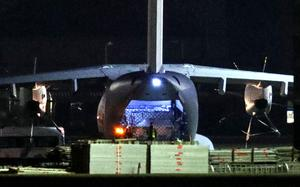 An RAF Atlas, believed to be carrying a cargo of PPE is unloaded at Brize Norton (Steve Parsons/PA)
