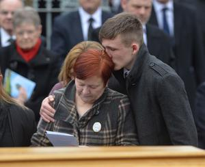 PACEMAKER BELFAST   22/03/2016 Sharon (wife) is comforted with Family and Friends During  The funeral cortege for murdered prison officer Adrian Ismay arrives at Woodvale Methodist Church this morning. Photo Colm Lenaghan/Pacemaker Press