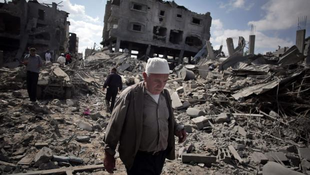 A Palestinian man inspects the damage of his destroyed house during a 12-hour cease-fire in Gaza City's Shijaiyah neighborhood, Saturday, July 26, 2014.  (AP Photo/Khalil Hamra)