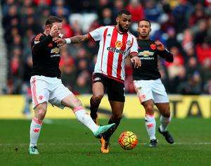 SUNDERLAND, ENGLAND - FEBRUARY 13:  Yann M'Vila of Sunderland and Wayne Rooney of Manchester United compete for the ball during the Barclays Premier League match between Sunderland and Manchester United at the Stadium of Light on February 13, 2016 in Sunderland, England.  (Photo by Clive Brunskill/Getty Images)