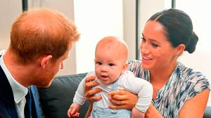 Public gaze: the Duke and Duchess of Sussex with baby Archie during their South Africa trip