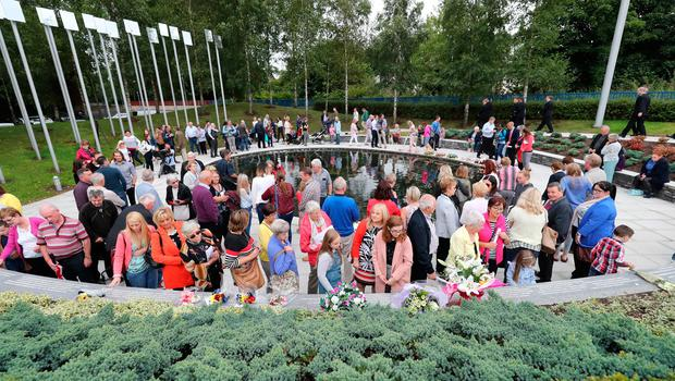 People visit the Omagh Memorial garden after attending the ceremony for victims of the car bomb on Market Street on the 15th August 1998. PRESS ASSOCIATION Photo. Picture date: Wednesday August 15, 2018. The worst single atrocity of the Northern Ireland conflict killed 29 people, including a woman pregnant with twins. See PA story ULSTER Omagh. Photo credit should read: Niall Carson/PA Wire