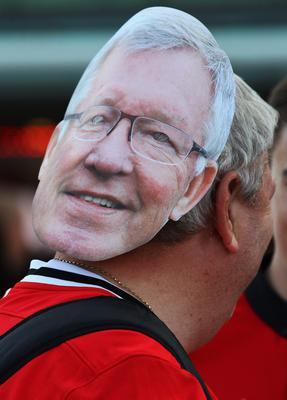 MANCHESTER, ENGLAND - AUGUST 26:  A Manchester United fan wears a Sir Alex Ferguson mask prior to the Barclays Premier League match between Manchester United and Chelsea at Old Trafford on August 26, 2013 in Manchester, England.  (Photo by Alex Livesey/Getty Images)