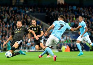 Manchester City's English midfielder Raheem Sterling (R) has a shot on goal during a UEFA Champions League group stage football match between Manchester City and Juventus at the Etihad stadium in Manchester, north-west England on September 15, 2015.     AFP PHOTO / OLI SCARFFOLI SCARFF/AFP/Getty Images