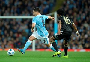 Manchester City's French midfielder Samir Nasri (L) controls the ball by Juventus' forward from Coombia Juan Cuadrado during a UEFA Champions League group stage football match between Manchester City and Juventus at the Etihad stadium in Manchester, north-west England on September 15, 2015.      AFP PHOTO / OLI SCARFFOLI SCARFF/AFP/Getty Images