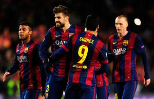 BARCELONA, SPAIN - MARCH 18:  Gerard Pique of Barcelona celebrates victory with Luis Suarez of Barcelona after the UEFA Champions League Round of 16 second leg match between Barcelona and Manchester City at Camp Nou on March 18, 2015 in Barcelona, Spain.  (Photo by David Ramos/Getty Images)