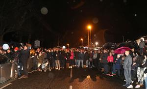 A massive crowd gathered at Crumlin Leisure Centre for a vigil in honour of Robert Flowerday who was found dead at his home in Crumlin, County Antrim. People then walked from the Leisure Centre to his home.