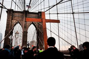 Members of the Archdiocese of New York and the Diocese of Brooklyn lead the Way of the Cross procession over the Brooklyn Bridge on April 3, 2015 in New York City. (Photo by Spencer Platt/Getty Images)