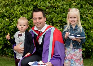 Alan McMichael graduated with a PhD from the School of Medicine, Dentistry and Biomedical Sciences at Queen's University Belfast. He is pictured celebrating with his son, Issac and niece, Macey.
