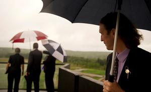 SHANKSVILLE, PA - SEPTEMBER 10:Somerset County Coroner Wally Miller braves the rain to look out over the grounds at the visitor center at the Flight 93 National Memorial on September 10, 2015 in Shanksville, Pennsylvania. The newly opened $26 million visitor center complex was dedicated in honor of the victims of Flight 93 on the evening of the 14th anniversary of the 9/11 attacks. (Photo by Jeff Swensen/Getty Images)